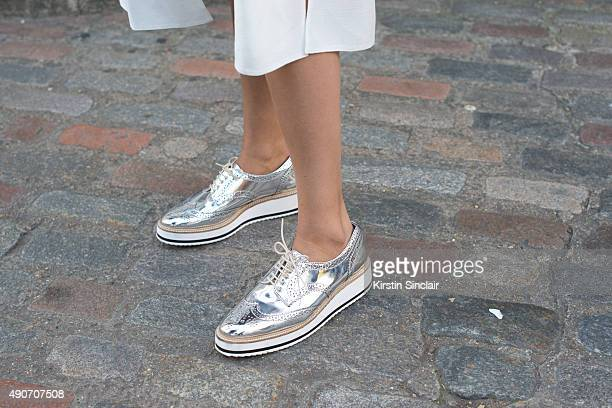 Fashion Blogger Julia Haghjoo wears a an ASOS top and Zara shoes on day 3 during London Fashion Week Spring/Summer 2016/17 on September 20 2015 in...
