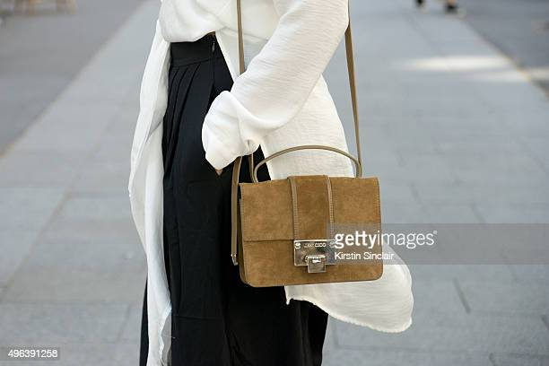 Fashion Blogger Julia Haghjoo wears a Asos top Tibi trousers and Jimmy Choo bag on day 5 during Paris Fashion Week Spring/Summer 2016/17 on October 3...