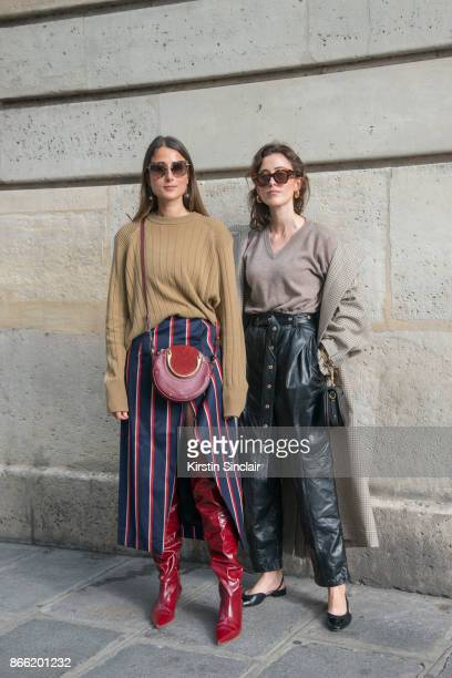 Fashion blogger Julia Haghjoo wears a Samsoe Samsoe sweater Solace London skirt Chloé bag Zara boots Tiffany earrings and Miu Miu sunglasses with...