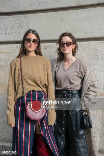 Fashion blogger Julia Haghjoo wears a Samsoe Samsoe sweater Solace London skirt Chloé bag Tiffany earrings and Miu Miu sunglasses with Fashion...