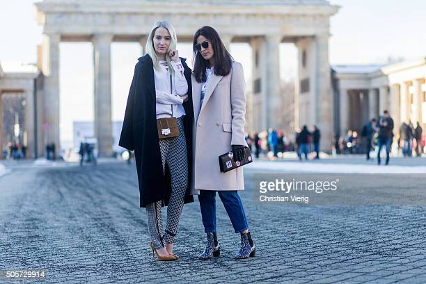 Fashion blogger Juliane Diesner of Style Shiver wearing Lala Berlin coat blouse and pants Jimmy Choo bag Gianvito Rossi shoes and Fashion Blogger...