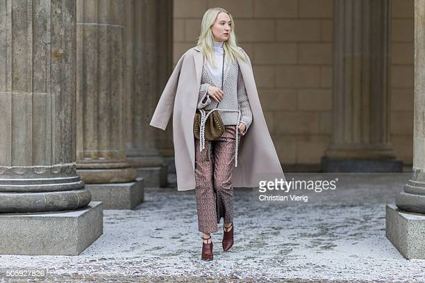 Fashion blogger Juliane Diesner of Style Shiver wearing sweater pants shoes Dorothee Schumacher turtleneck Lala Berlin coat Topshop bag Chloe outside...