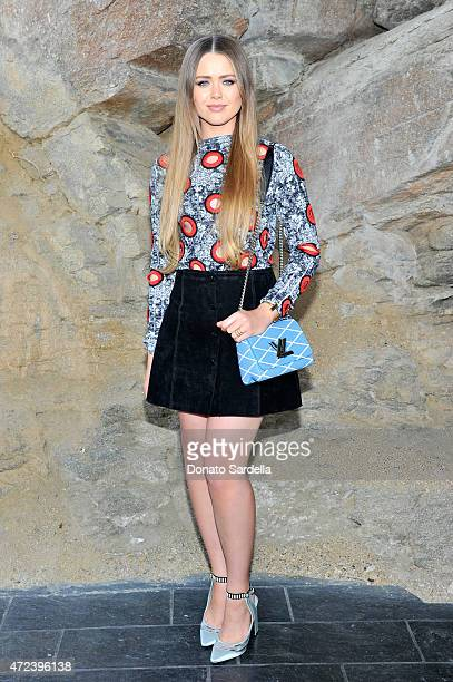 Fashion blogger Kristina Bazan attends the Louis Vuitton Cruise 2016 Resort Collection shown at a private residence on May 6 2015 in Palm Springs...