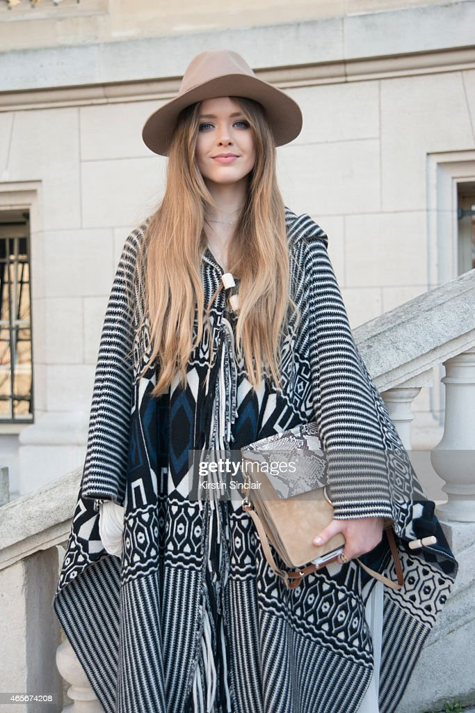 Fashion blogger Kristina Bazan wears a Chloe cape, dress and bag at the Chloe show on day 6 of Paris Collections: Women on March 08, 2015 in Paris, France.