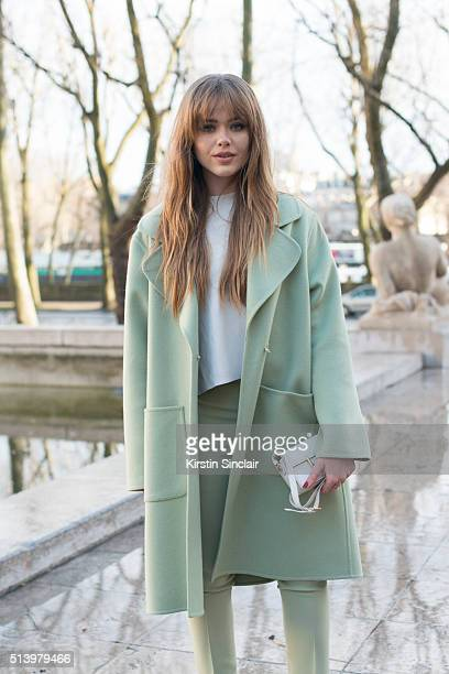 Fashion blogger Kristina Bazan wears Rochas jacket trousers and bag on day 2 during Paris Fashion Week Autumn/Winter 2016/17 on March 2 2016 in Paris...