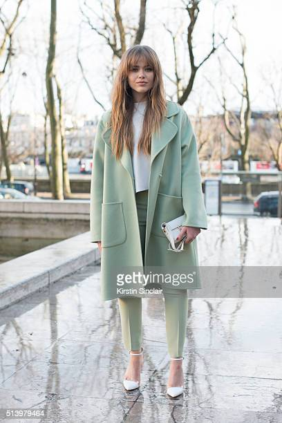 Fashion blogger Kristina Bazan wears Zara shoes Rochas jacket trousers and bag on day 2 during Paris Fashion Week Autumn/Winter 2016/17 on March 2...