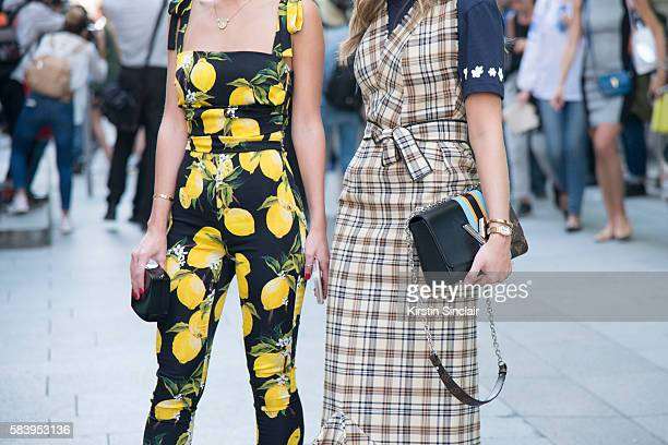 Fashion blogger Lala Rudge wears a Dolce Gabbana jumpsuit Chanel clutch bag with Fashion blogger Thassia Naves who wears a La Gaconne dress Adidas by...