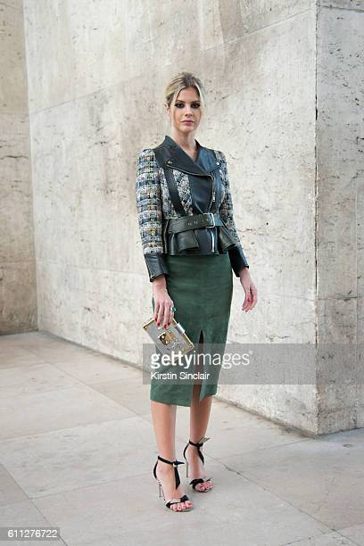 Fashion blogger Lala Rudge wears an Alexander McQueen jacket Cruise skirt Louis Vuitton bag and Alexander Birman shoes on day 2 of Paris Womens...