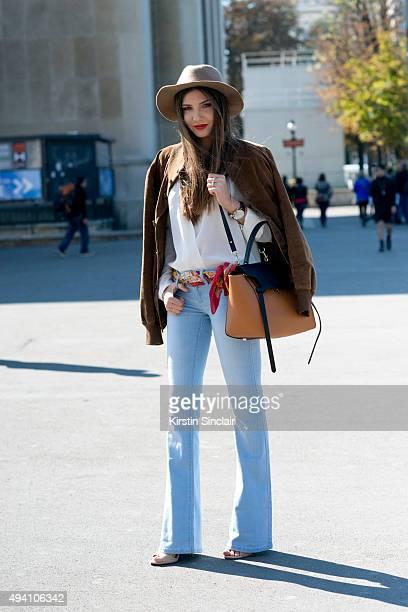 Fashion Blogger Larisa Costea wears a vintage jacket Stefanel shirt YMI jeans Jessica Buurman bag and shoes Topshop hat and a Daniel Wellington watch...