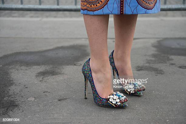 Fashion Blogger Laura Comoli wears a Stella Jean dress and Gedebe shoes on day 8 during Paris Fashion Week Autumn/Winter 2016/17 on March 8 2016 in...