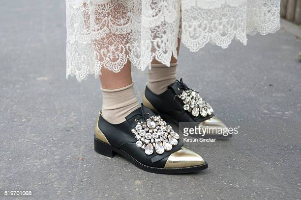 Fashion Blogger Laura Comolli wears a Mes Demoiselles dress and Judari shoes on day 6 during Paris Fashion Week Autumn/Winter 2016/17 on March 6 2016...