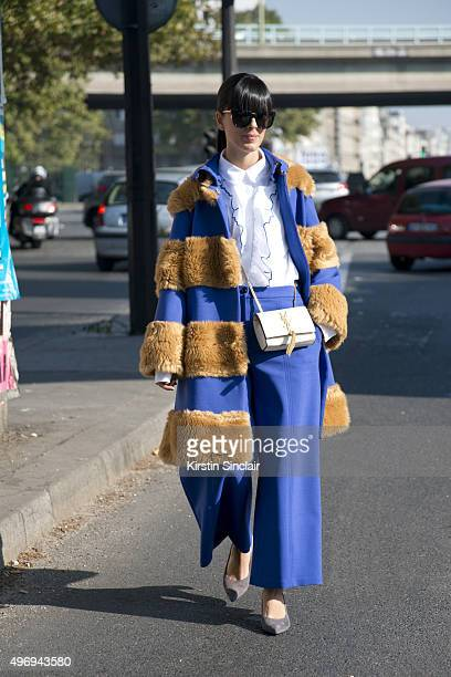 Fashion Blogger Laura Comolli wears all Jivetti Le Baba shoes Yves Saint Laurent bag and Gentle Monster sunglasses on day 6 during Paris Fashion Week...