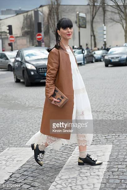 Fashion Blogger Laura Comolli wears Erika Cavallini coat Mes Demoiselles dress Lina Brax bag and Judari shoes on day 6 during Paris Fashion Week...
