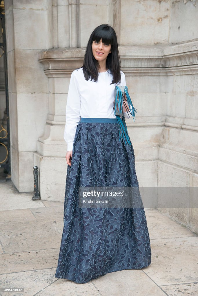 Fashion blogger Laura Comolli wears Jiljil skirt, vintage shirt, and Lina Brox bag on day 7 of Paris Collections: Women on March 09, 2015 in Paris, France.