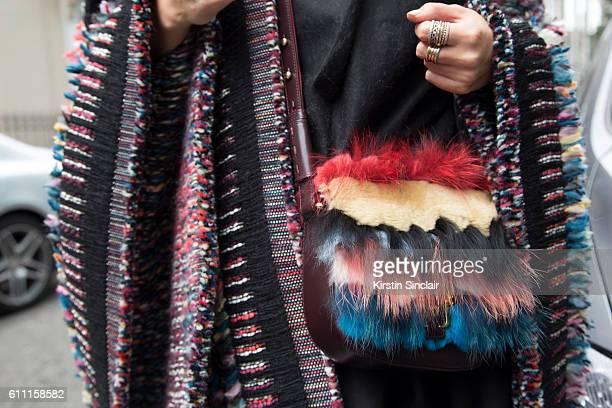 Fashion blogger Leonie Hanne wears a Chloe coat and Paula Cademartori bag on day 3 of London Womens Fashion Week Spring/Summer 2017 on September 18...