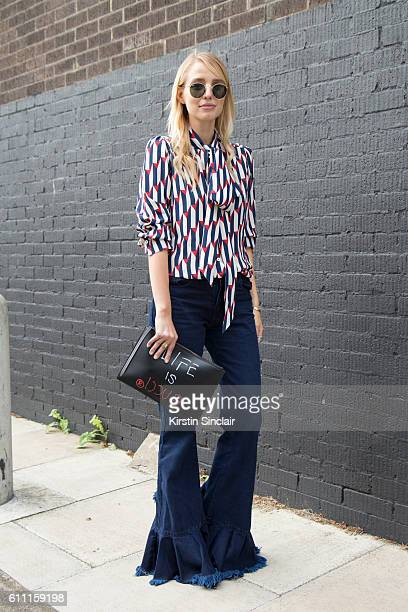 Fashion blogger Leonie Hanne wears Gucci shirt and bag Marques Almeida trousers Proenza Schouler shoes and RayBan sunglasses on day 3 of London...