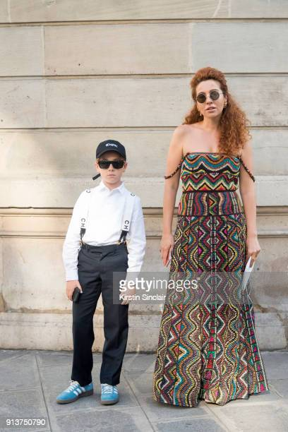 Fashion blogger Lil Kid Ivan Zinko wears Adidas trainers with a white shirt black trousers and braces with his Mum Fashion and jewellery designer...