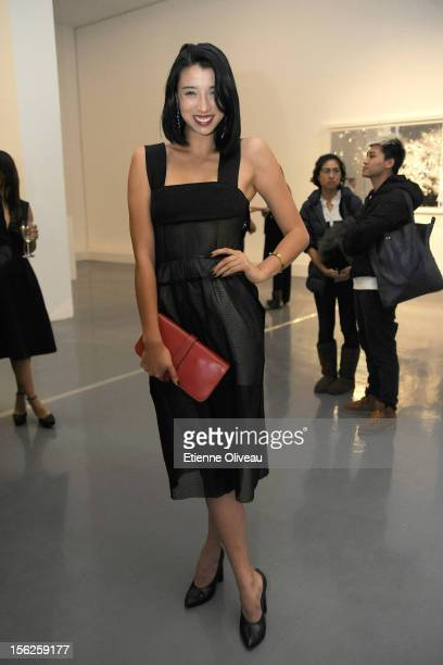 Fashion Blogger Lily Kwong poses for pictures during the Calvin Klein special dinner at the Long March Space in 798 Art District on November 12 2012...