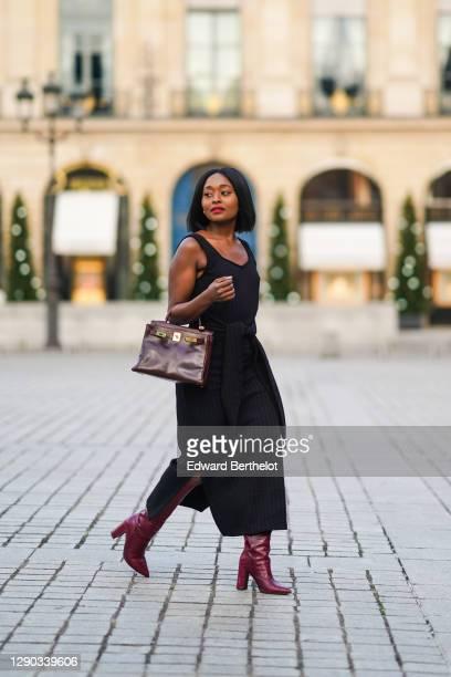 Fashion blogger Linaose wears a black slit dress from Sancia, a burgundy leather bag Kelly Hermes 28, purple leather crocodile pattern high heeled...