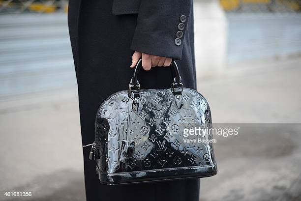 Fashion blogger Linda Tol poses wearing an Ann Demeulemeester coat and Louis Vuitton bag on January 17 2015 in Milan Italy