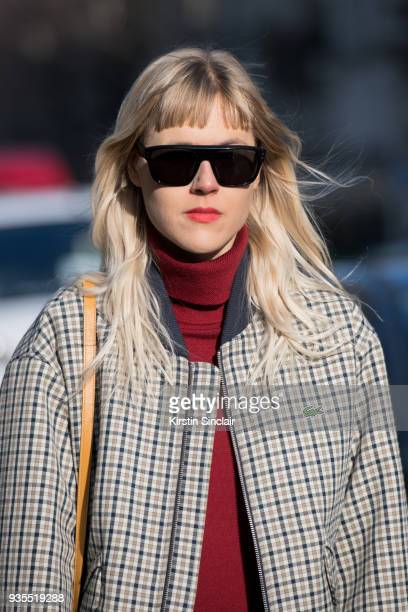 Fashion blogger Linda Tol wears a Lacoste jacket and Privee sunglasses day 3 of Paris Womens Fashion Week Spring/Summer 2018 on February 28 2018 in...