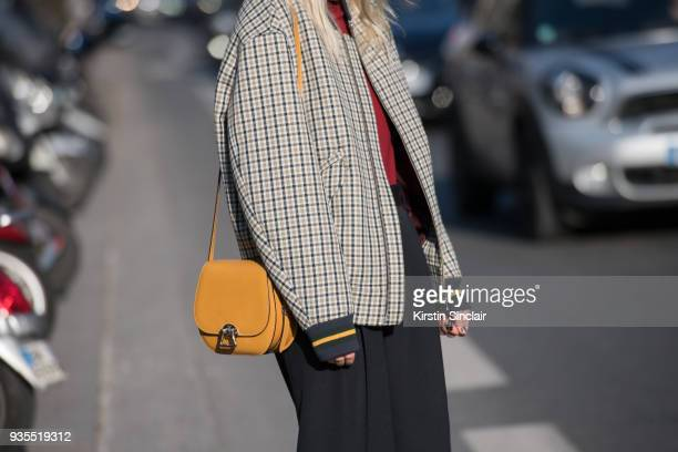 Fashion blogger Linda Tol wears a Lacoste jacket Celine trousers Moynat bag day 3 of Paris Womens Fashion Week Spring/Summer 2018 on February 28 2018...