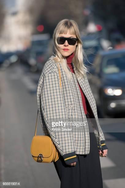 Fashion blogger Linda Tol wears a Lacoste jacket Celine trousers Moynat bag Salle Privee sunglasses day 3 of Paris Womens Fashion Week Spring/Summer...