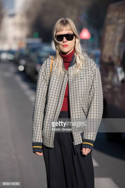 Fashion blogger Linda Tol wears a Lacoste jacket Celine trousers Salle Privee sunglasses day 3 of Paris Womens Fashion Week Spring/Summer 2018 on...