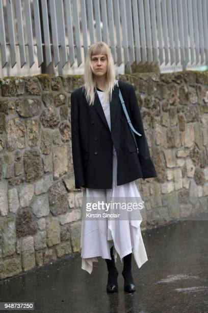 Fashion blogger Linda Tol wears a Loewe dress Celine boots and an Acne jacket day 5 of Paris Womens Fashion Week Spring/Summer 2018 on March 2 2018...