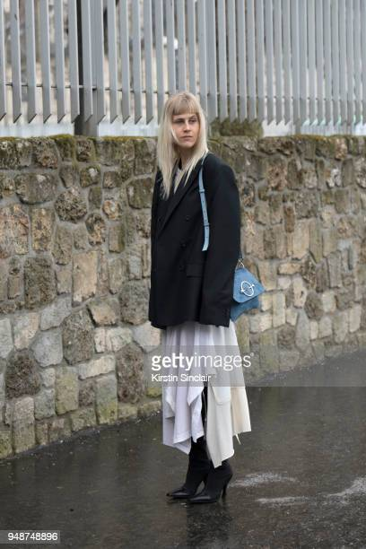 Fashion blogger Linda Tol wears a Loewe dress Celine boots JW Anderson bag and an Acne jacket day 5 of Paris Womens Fashion Week Spring/Summer 2018...