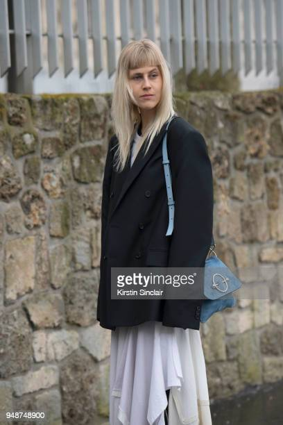 Fashion blogger Linda Tol wears a Loewe dress JW Anderson bag and an Acne jacket day 5 of Paris Womens Fashion Week Spring/Summer 2018 on March 2...