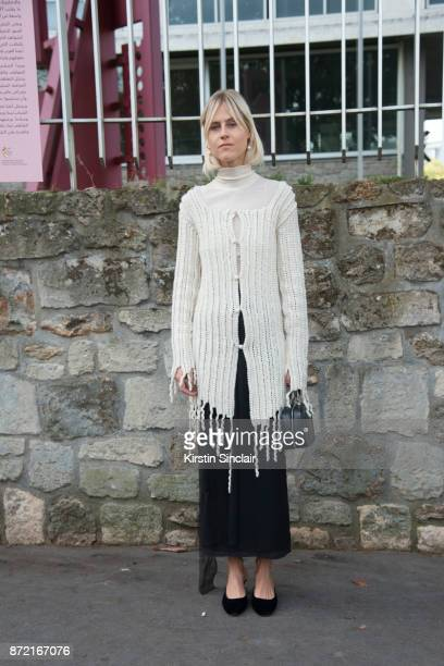 Fashion blogger Linda Tol wears a Loewe sweater and skirt and Rochas shoes day 4 of Paris Womens Fashion Week Spring/Summer 2018 on September 29 2017...