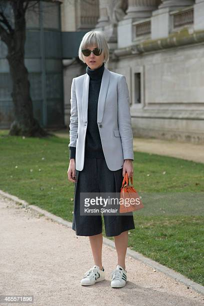 Fashion Blogger Linda Tol wears Louis Vuitton bag LK Bennett jacket Dries Van Noten trousers Uniqlo sweater Adidas shoes and Mykita sunglasses on day...