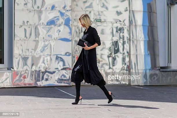 Fashion blogger Lisa Hahnbueck wearing a black DKNY Merino Wool Cardi Dress a black Asymmetric Slip Dress black Christian Louboutin Kristy Overkness...