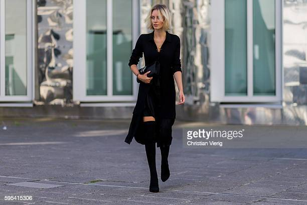 Fashion blogger Lisa Hahnbueck wearing a black DKNY Merino Wool Cardi Dress a black Asymmetric Slip Dress black Christian Louboutin Kristy Overkness...