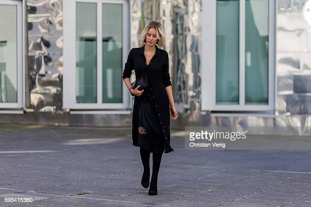 3ca59659665a Fashion blogger Lisa Hahnbueck wearing a black DKNY Merino Wool Cardi Dress  a black Asymmetric Slip