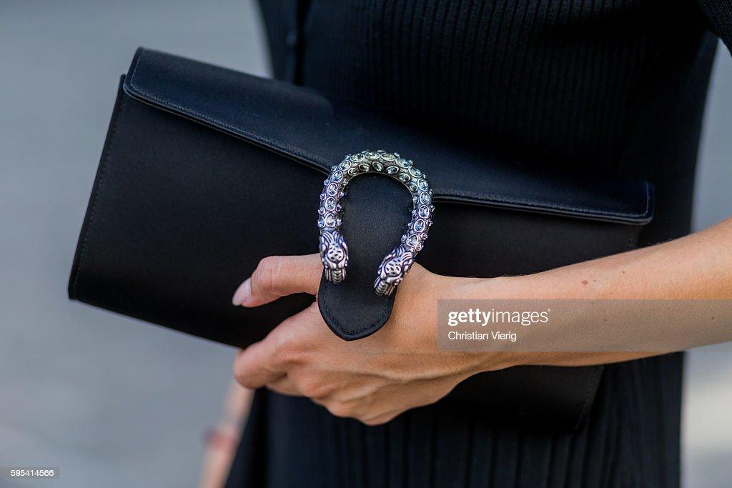 b1d1bece3f2c Fashion blogger Lisa Hahnbueck wearing a black Gucci Dionysus Clutch ...