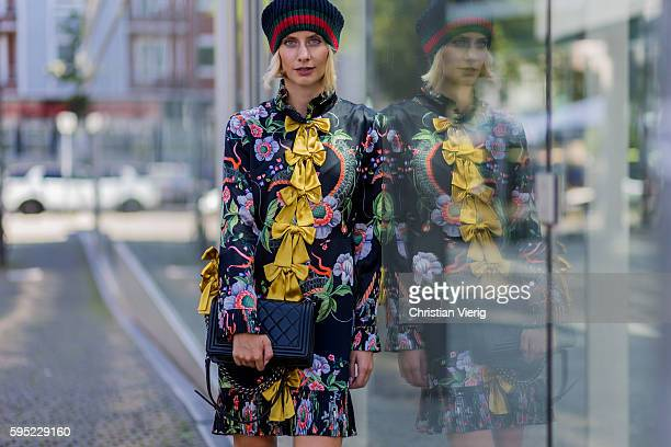 Fashion blogger Lisa Hahnbueck wearing a Gucci Silk Dress with yellow bows and floral print Gucci wool cap black Chanel Boy Bag on August 25 2016 in...