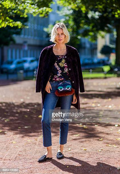 Fashion blogger Lisa Hahnbueck wearing a purple lambskin coat AliceOlivia OffShoulder blouse with floral embroideries blue denim Paige Jeans black...