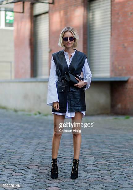730923daa3f6 Fashion blogger Lisa Hahnbueck wearing black Set leather vest white Cos  Maxi Sleeve black Mai Più