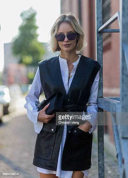 1aefaa563b72 Fashion blogger Lisa Hahnbueck wearing black Set leather vest white Cos  Maxi Sleeve black Gucci Dionysus