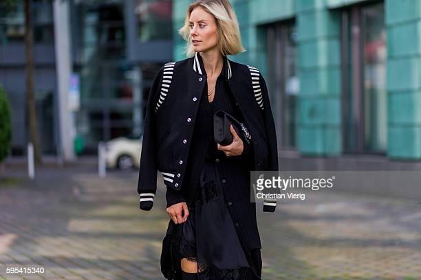 Fashion blogger Lisa Hahnbueck wearing black white Saint Laurent College Jacket black DKNY Merino Wool Cardi Dress black Asymmetric Slip Dress black...