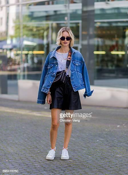 Fashion blogger Lisa Hahnbueck wearing blue denim Balenciaga Jeans jacket, black Set Leather Shorts, white Iro T-Shirt, white Puma Fenty Sneaker,...