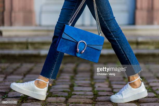Fashion blogger Lisa Hahnbueck wearing blue denim Paige Jeans white Puma Fenty Sneaker blue Gucci Dionysus Bag on August 25 2016 in Duesseldorf...