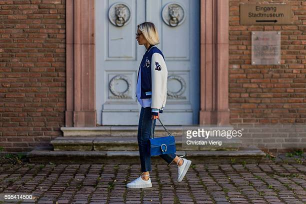 Fashion blogger Lisa Hahnbueck wearing Dior Abstract sunglasses a white blue MSGM College Jacket Cat Application white Vince Cashmere Knit blue denim...