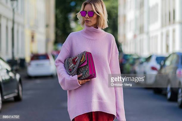 Fashion blogger Lisa Hahnbueck wearing Dior Abstract sunglasses a pink Celine Cashmere Turtle Neck red Celine Silk Pants Gucci Dionysus Bag on August...