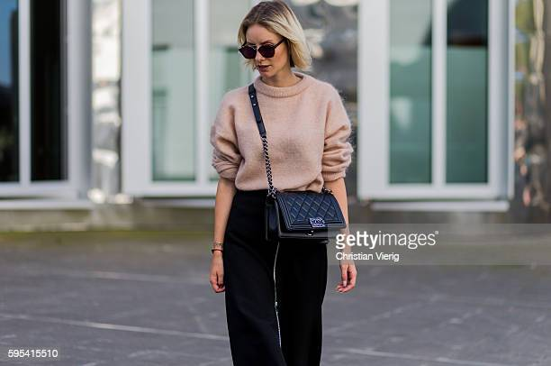 Fashion blogger Lisa Hahnbueck wearing Dior Abstract sunglasses a salmon pink Acne Merino Knit black Set Midi Skirt black Chanel Boy Bag on August 25...