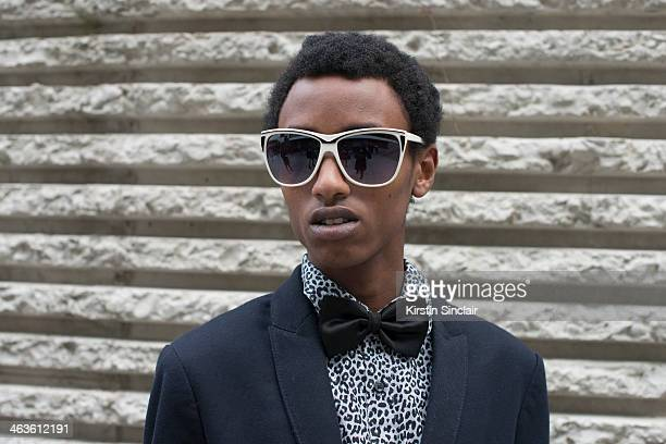 Fashion blogger Loric Juston wears an H and M shirt Zara jacket and vintage sunglasses day 4 of Paris Mens Fashion Week Autumn/Winter 2014 on January...