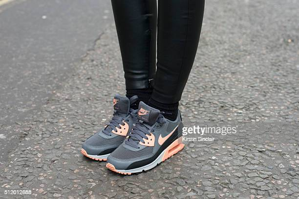 Fashion blogger Luana Codreanu wears Zara trousers and Nike trainers on day 5 during London Fashion Week Autumn/Winter 2016/17 on February 23 2016 in...