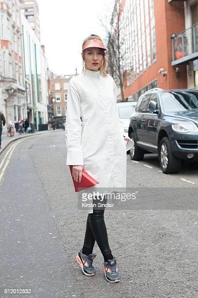 Fashion blogger Luana Codreanu wears Zara trousers Hedare visor Funkers dress shirt Nike trainers and a Laura Geteanu clutch bag on day 5 during...